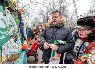 Russia, Moscow - March 16, 2019: Celebration of St. Patrick's Day in Moscow Park Sokolniki. Shop with holiday symbols. Shop with holiday symbols. People buy souvenirs.