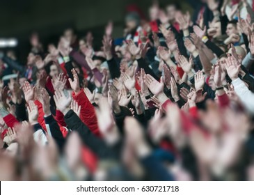 RUSSIA, MOSCOW, MARCH, 2017:  Football fans clapping on the podium of the stadium Otkrytie
