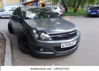 Russia, Moscow - May 04, 2019: Gray metallic Opel Astra modified to Stance style. Car with big custom steel wheels parked on the street. Front side view
