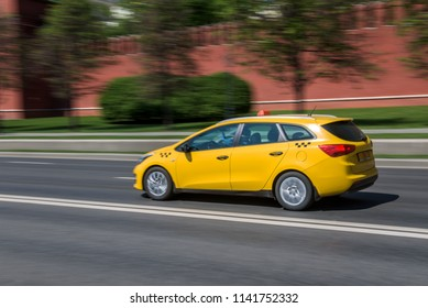 Russia, Moscow - May 13, 2018: Motion city street scene with a yellow taxi