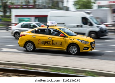 Russia, Moscow - May 13, 2018: Motion city street scene with a yandex taxi
