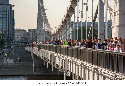 Russia, Moscow - May 13, 2018: People walkin on Krymsky Bridge