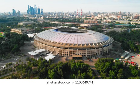 RUSSIA MOSCOW MAY 2018: Flying around the stadium Luzhniki. Moscow-city towers on the horizon. Beautiful day with bright blue and a little hazy sky.