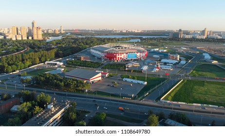 RUSSIA MOSCOW MAY 2018: Flying around the Stadium Discovery Arena. Picturesque cityscape with the park view and river on the horizon. Beautiful sunset in the city.