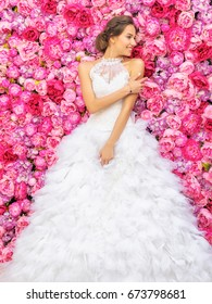 RUSSIA, MOSCOW - MAY 29, 2016: Photo event with fashion model in the image of the bride on a background decorations of flowers