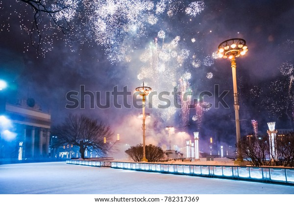Russia. Moscow. New year's eve night at VDNH. Fireworks over the world's largest skating rink. Holiday events celebrations