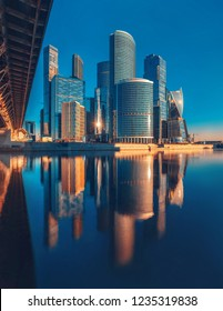 "Russia, Moscow - November 16, 2018: Business Center Moscow-City. Towers and their reflection in the Moscow River. Modern architecture. Moscow International Business Center ""Moscow-City"""