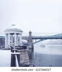 Russia, Moscow - November 28, 2017: Gorky Park, Bridge and ship of the Radisson flotilla in the snow.
