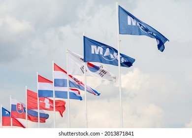 Russia. Moscow oblast. Zhukovsky. July 21, 2021. MAKS-2021 Air Show. Flags of the MAKS Air Show and other foreign countries on the airfield of the air show