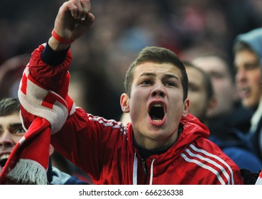 RUSSIA, MOSCOW, OCTOBER 2015: Fans of the Spartak football club at the Russian Football Championship match between teams Dynamo football club and Spartak football club