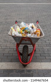 Russia, Moscow on August 2, 2018. Garbage, wrapping and wrapping food products in a wheelbarrow, slaughtering streets.