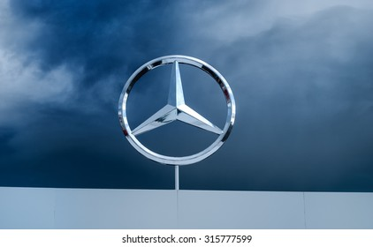 RUSSIA, MOSCOW RACEWAY, AUGUST 28, 2015: Mercedes-Benz sign against dark brown sky . Mercedes-Benz is a multinational division of the German manufacturer Daimler AG.