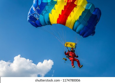 Russia Moscow region Vatulino. 05.17.2018 Colorful parachut on blue cloudy sky. Parachute jumps. Active life style.
