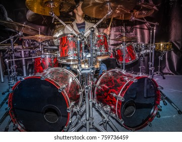 """RUSSIA, MOSCOW - SEPTEMBER 16, 2017: International Music Exhibition """"NAMM Musikmesse Russia 2017"""". The drummer is behind the drum set. Drums and plates."""