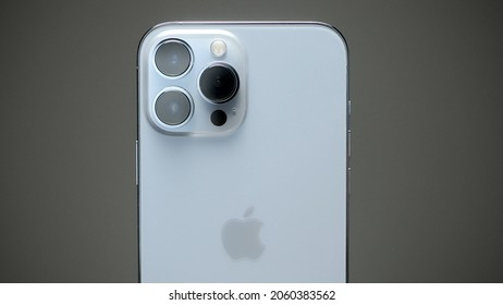 RUSSIA, MOSCOW - SEPTEMBER 27, 2021: New iPhone 13 pro. Action. Advertising video with external design of iPhone 13 pro. Stylish exterior design of new iPhone with metal case and three cameras
