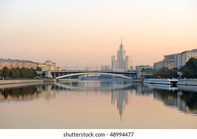 Russia. Moscow. View on classical Stalin's tower building on Kotelnicheskaya quay across Moskva river at a sunrise and Ust'inskiy bridge