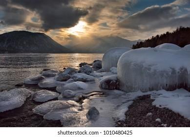 Russia. mountain Altai. Sunset on lake Teletskoye.