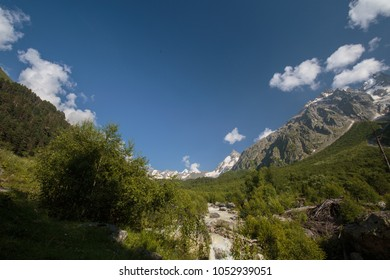 Russia. Movement of clouds and water flows in a stormy river in the Caucasus mountains in summer
