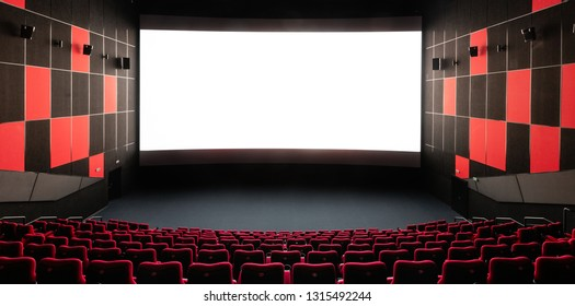 Russia, Nizhny Novgorod - November 14, 2016: Cinema Imperia Grez Nebo, Dolby Atmos. Empty red cinema hall seats, comfortable and soft chairs. Perspective auditorium view with white space on the screen