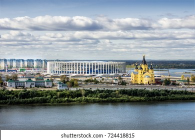 Russia, Nizhny Novgorod - Sep 24, 2017: View from the high bank of the Oka River to the stadium under construction and the Alexander Nevsky temple