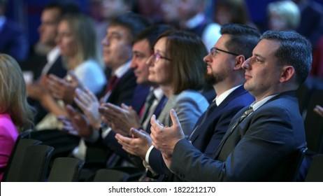 Russia, Novosibirsk, 21 sep, 2019: Crowd people listen speaker. Audience business meet forum. Auditorium viewer listen speaker. political summit business man. Group people listening speech crowd.