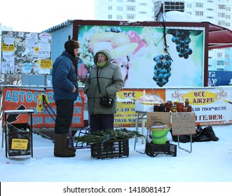 Russia, Novosibirsk, 3 December 2018: Man and woman street vendors unauthorized prohibited trade in stalls on the street in Novosibirsk violate the law