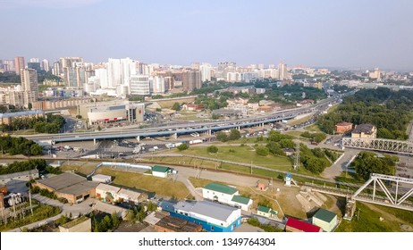Russia, Novosibirsk - July 19, 2018: First Railway Bridge in Novosibirsk. Panorama of the city of Novosibirsk. View on the river Ob. Russia, From Dron