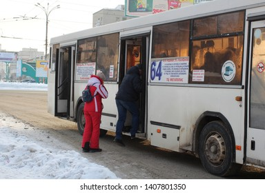 Russia, Novosibirsk, Narymskaya street January 2, 2019: A lot of people waiting for passengers at the bus stop public transport in Novosibirsk in winter Shuttle bus landing