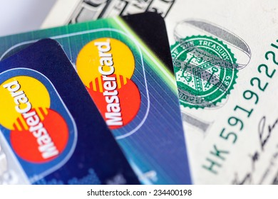 RUSSIA, OREL - 01 DECEMBER 2014: Two credit cards by Mastercard and dollar bills