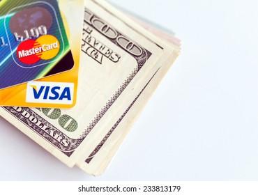 RUSSIA, OREL - 28 NOVEMBER 2014: Two credit cards by Mastercard and Visa and dollar bills
