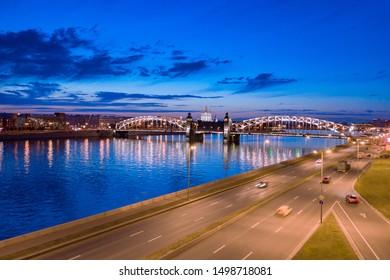 Russia. Panoramic view of the night St. Petersburg. Bridges Of Petersburg. Bolsheokhtinsky bridge. Peter The Great Bridge. Rivers Of St. Petersburg. The Petersburg road. White night.