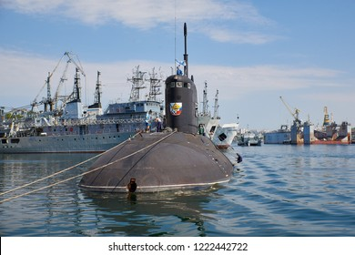 "Russia, the peninsula of Crimea, the city of Sevastopol. 21 june 2018:  Russian submarine ""Novorossiysk"" degaussing by crew at Southern bay of Sevastopol Harbor, nose view."