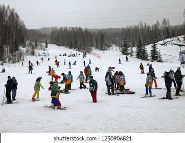 Russia, Perm - January 3, 2017: Children's group for training snowboarders and skiers slalom. Snowboarding and Skiing as youth craze