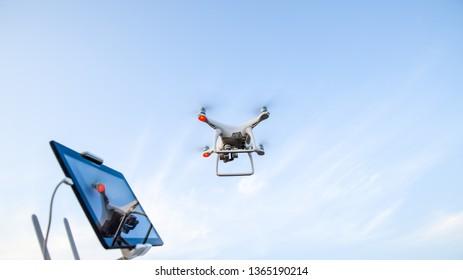 Russia, Poltavskaya village - 28 August 2016: Quadrocopters 4 Phantom and a remote control for it. Quadrocopters against the blue sky. Umravlenie quadrocopters 4 Phantom.
