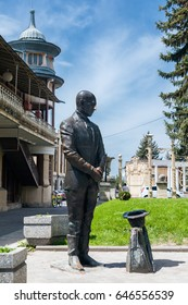 """Russia, Pyatigorsk - May 2017; Resort Pyatigorsk, a sculpture of the character of the novel """"Twelve Chairs"""" - Kisa Vorobyaninov asks mercy in the park """"Flower Garden""""."""