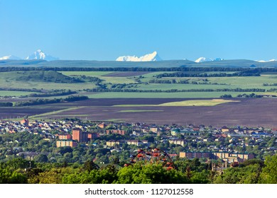 Russia, the region of Caucasian Mineral Waters, SPA resort of Essentuki, view of the city from a height, against the backdrop of the mountains of the main Caucasian ridge (in a light haze).
