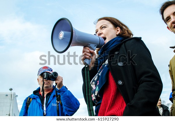 Russia. Rostov-on-Don. March 26.2017: A rally (approved by the authorities) aimed at fighting corruption. The girl speaker speaks in a megaphone at a meeting in the Russian Federation.