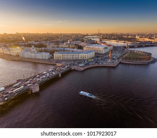 Russia, Saint Petersburg, 02 November 2017: Aerial view of The Vasilievskiy Island at sunset, Rostral Columns, Stock Exchange Building, Palace Bridge,  Cabinet of curiosities, Museum of anthropology