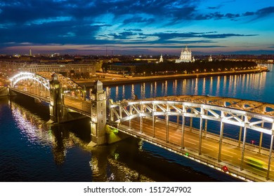 Russia. Saint Petersburg. Bolsheokhtinsky bridge. The Bridge of Peter the Great. Bridge at night Illumination. Canals of Petersburg. Cruise to St. Petersburg. Russian Federation. River walks.
