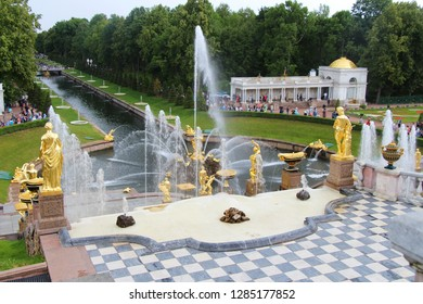 Russia, Saint Petersburg - July 19, 2013: View on Grand Cascade and Samson Fountain from Peterhof Palace. It's majestic ensemble of fountains with unique, opulent architecture & golden statues.