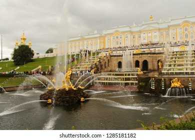 Russia, Saint Petersburg - July 19, 2013: View on Grand Cascade, Samson Fountain and Peterhof Palace. It's majestic ensemble of fountains with unique, opulent architecture & golden statues.