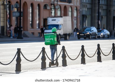 Russia, Saint Petersburg, may 23, 2020:courier for delivery to the house in the street of the empty city