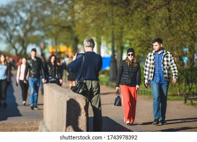 Russia, Saint Petersburg, may 23, 2020:people on a walk on the embankment after the quarantine