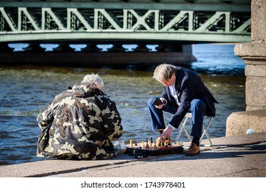 Russia, Saint Petersburg, may 23, 2020: two men play chess on the embankment