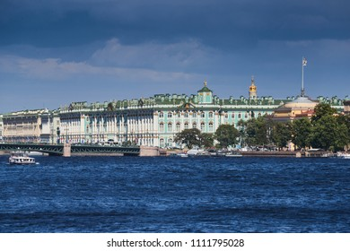 Russia, Saint Petersburg, The museum Hermitage, Palace Bridge, the Admiralty building, Andreevsky flag, sea navigation on the Neva River, the tourist boat, a clear sunny weather, a gold dome