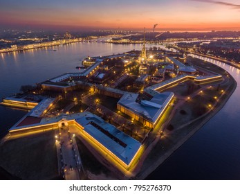Russia, Saint-Petersburg, 02 November 2017: Aerial photo of Peter and Paul Fortress at sunset, cathedral, traffic, nightlights, illumination, clear weather, reflections, cityscape, landmark, Hermitage