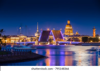 Russia, Saint-Petersburg, 10 July 2017:  The Admiralty Building at night, Palace Bridge, Isaac cathedral, night illumination, traffic, sail boats, reflection on water, moon way, rostral columns
