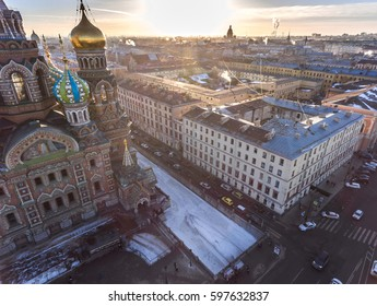 Russia, Saint-Petersburg, 15 February 2017: Aerial view of the cathedral Church of the Savior on Blood at sunset, gold domes, roofs, power, the frozen Griboyedov Canal, winter landscape