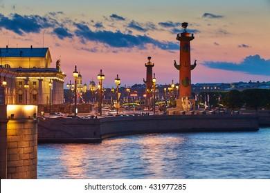 Russia, Saint-Petersburg, 22 May 2016: Traffic on the Birzhevaya square at sunset, water mirror, reflections, Birzhevoy, Dvorcovy, Palace bridge, Stock Exchange Building, Rastralnye columns