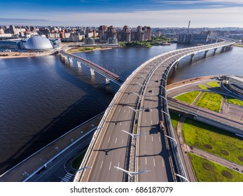 Russia, Saint-Petersburg, 23 July 2017: Aerial view of the highway North West diameter, walking bridge, aqua park Piterland, sunny day, morning, nobody, river Neva
